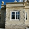 Punched bathstone quoins and Batted Marnhull stone ashlar
